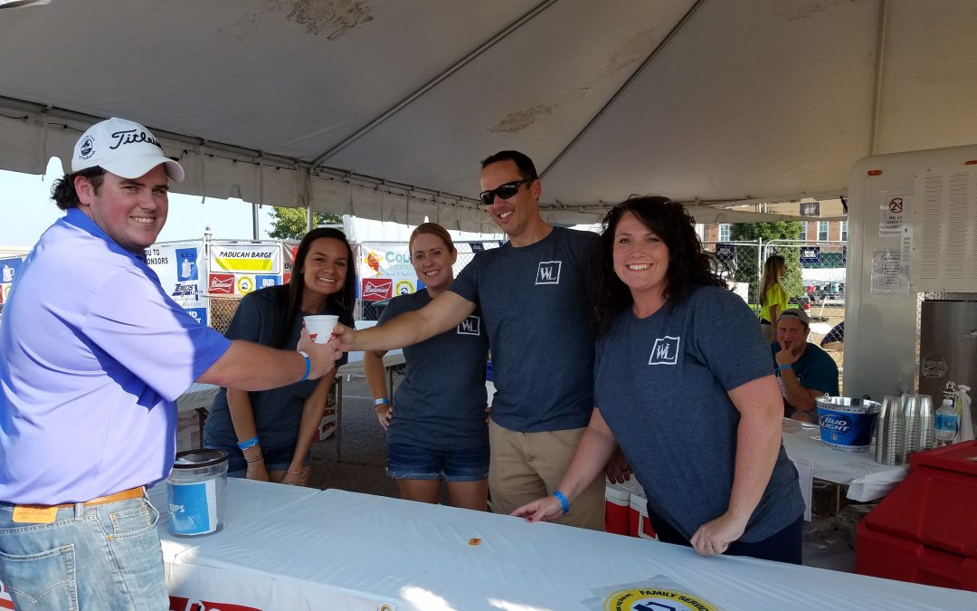 WWL Works Family Service Society Booth at BBQ on the River