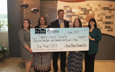 Kim Beanland and Family Service Society receive check from Iron Mom