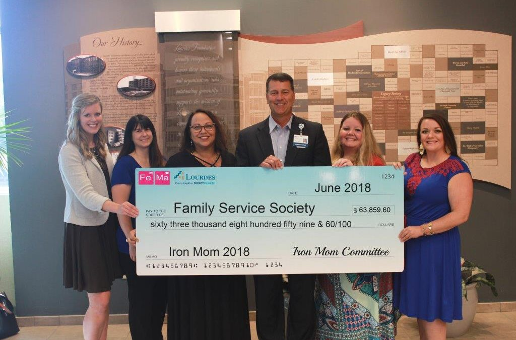 Kim Beanland Once Again Receives Check on Behalf of the Family Service Society